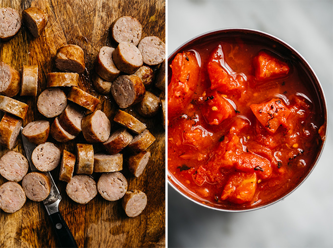Sliced cooked italian sausages on a cutting board, and a can of fire roasted diced tomatoes.