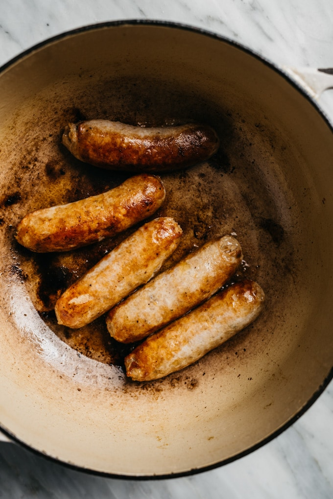 Browned italian sausages in a dutch oven.