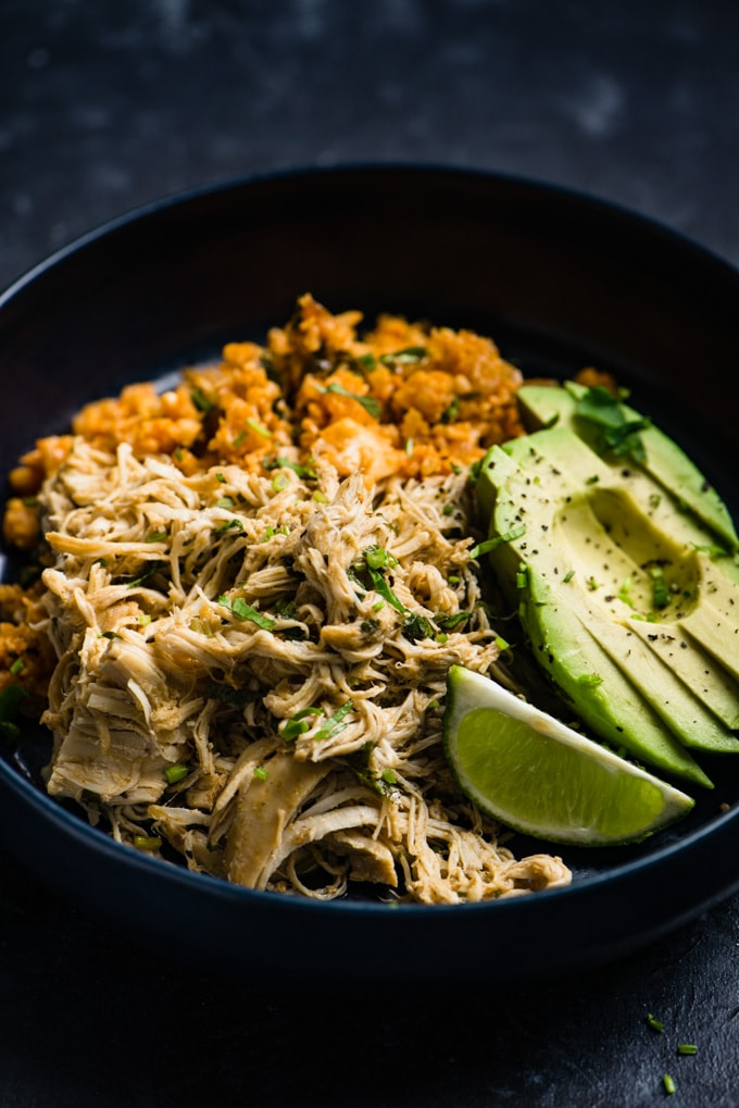 A low carb cilantro lime chicken bowl with Mexican cauliflower rice and avocado.
