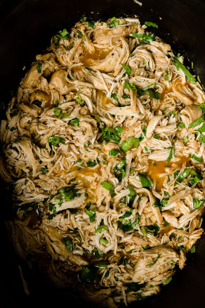 Shredded cilantro lime chicken in a crock pot.