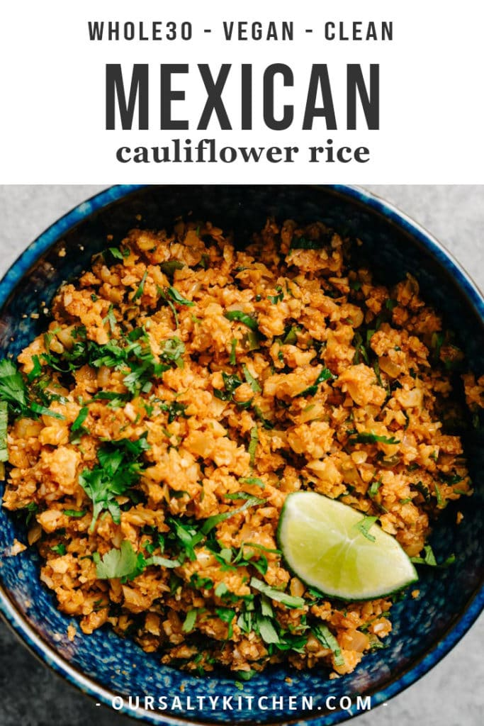 Gluten free mexican cauliflower rice in a blue bowl with cilantro and a lime wedge.