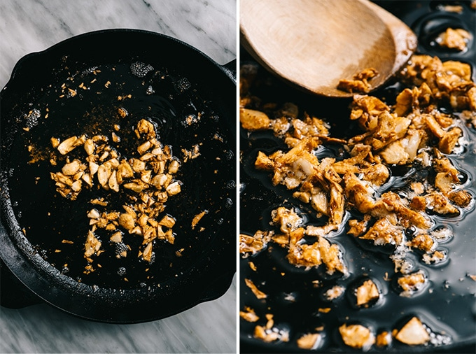 Sauteed garlic cloves in a cast iron skillet, whole and then smashed.