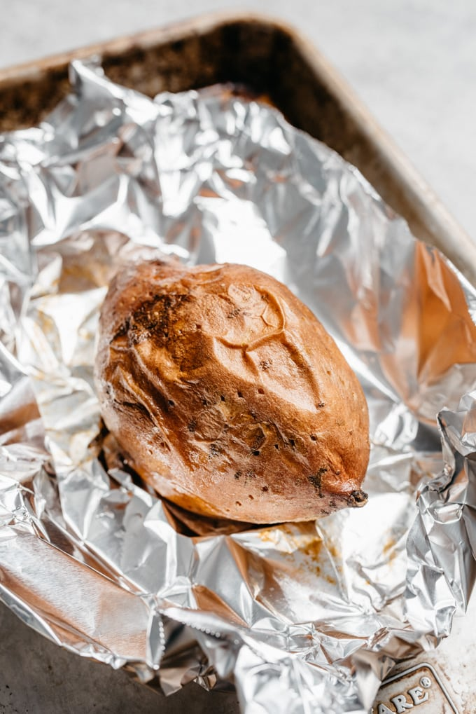 A quick oven roasted sweet potato on a piece of foil.