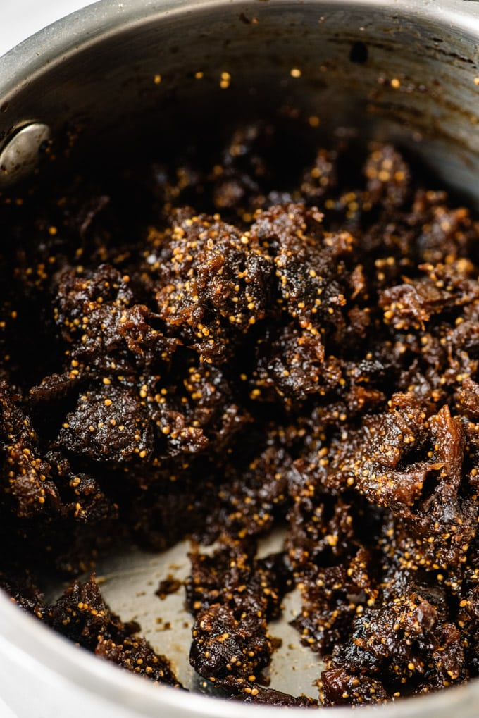 Fig puree made from dried figs in a small saucepan.