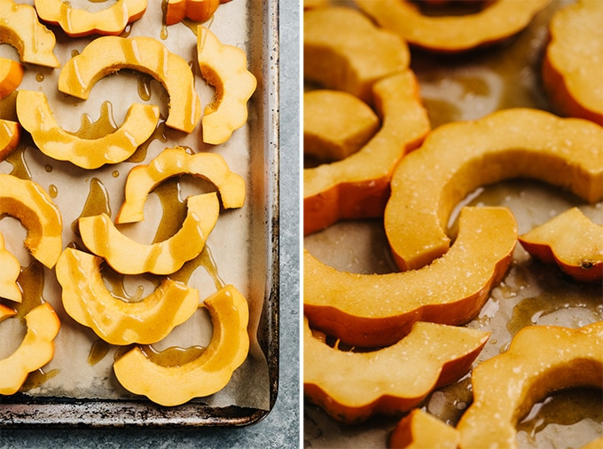 Acorn squash drizzled with maple brown butter on a roasting sheet.