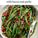 Pinterest image for a recipe for green beans with bacon and garlic.