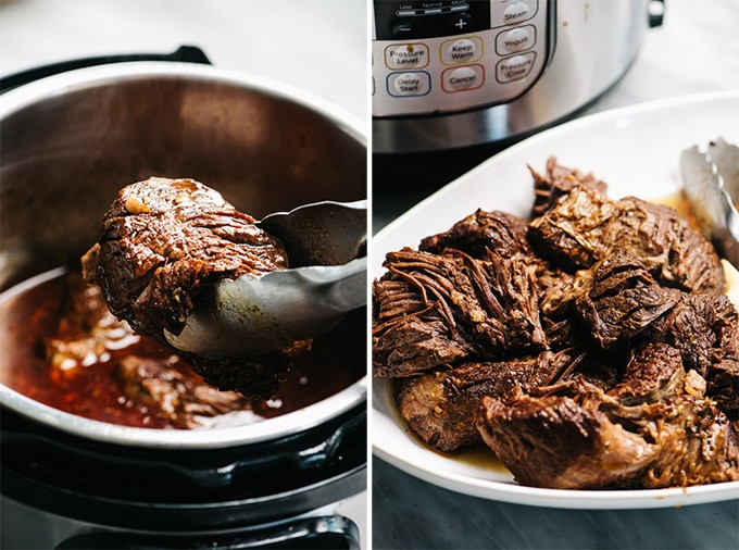 Chunks of cooked pot roast being removed from an instant pot with tongs.