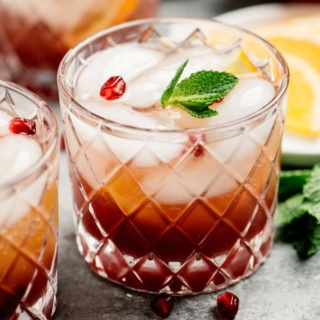 Three glasses of sparkling pomegranate punch.