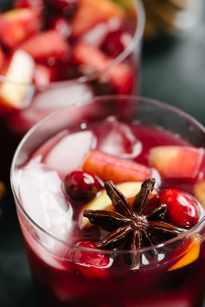 Close up image of holiday sangria showing star anise, cloves, and seasonal fruit.
