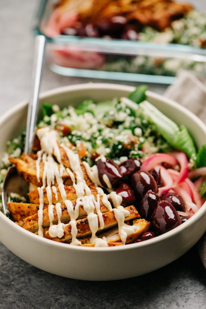 Side view, whole30 chicken shawarma bowl with cauliflower tabbouleh.