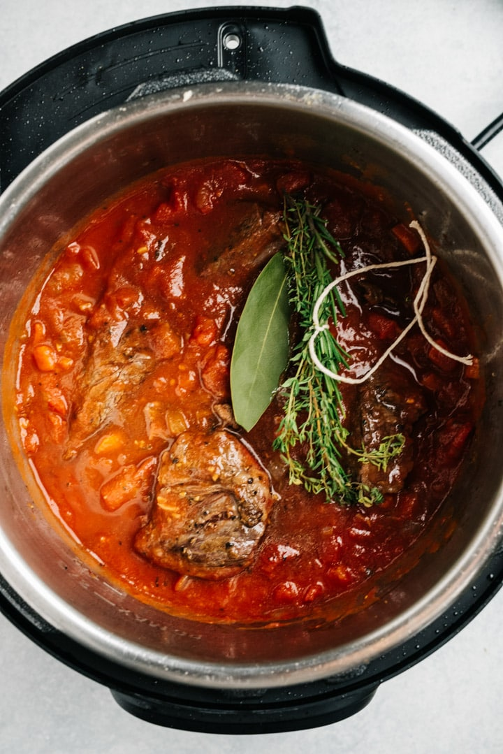 The ingredients for beef ragu in the instant pot before cooking.