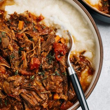 A bowl of Whole30 Instant Pot Beef Ragu served over mashed cauliflower.