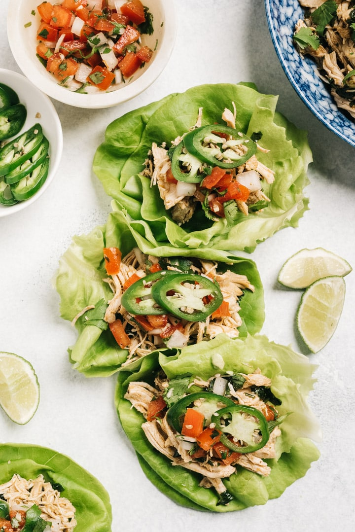 Three paleo lettuce cups stuffed with instant pot cilantro lime chicken.