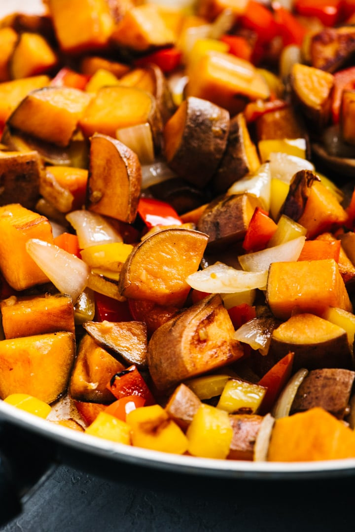 Side view, whole30 sweet potato hash in a saute pan.