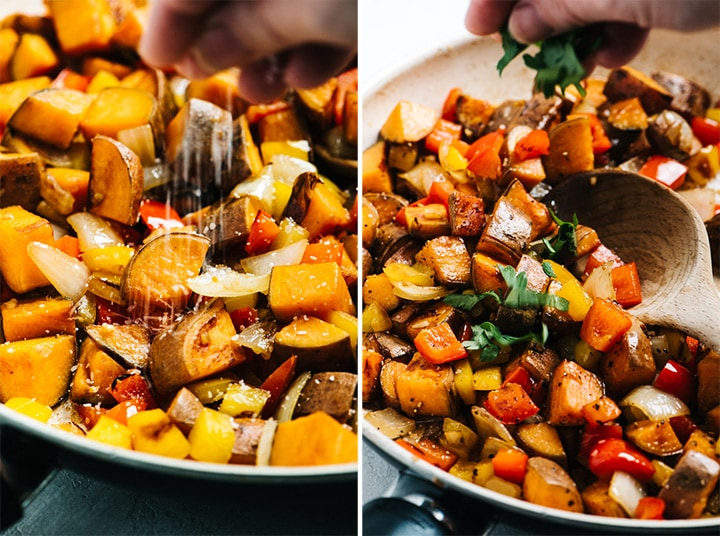 Sweet potato hash in a pan being seasoned with salt and chopped parsley.
