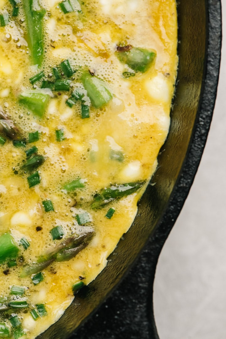 The edge of the cooked asparagus frittata