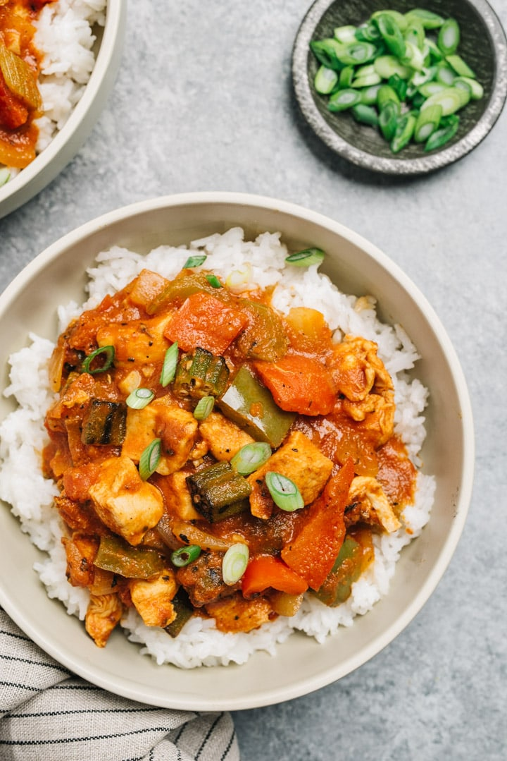 Cajun chicken served in a bowl over rice