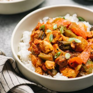 Close up of cajun chicken served in a bowl with rice