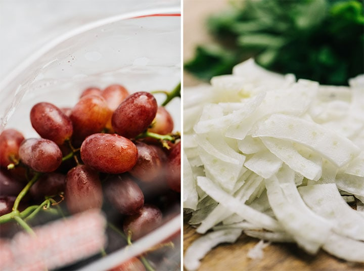 Red grapes in a bag and thinly sliced fennel on a cutting board.