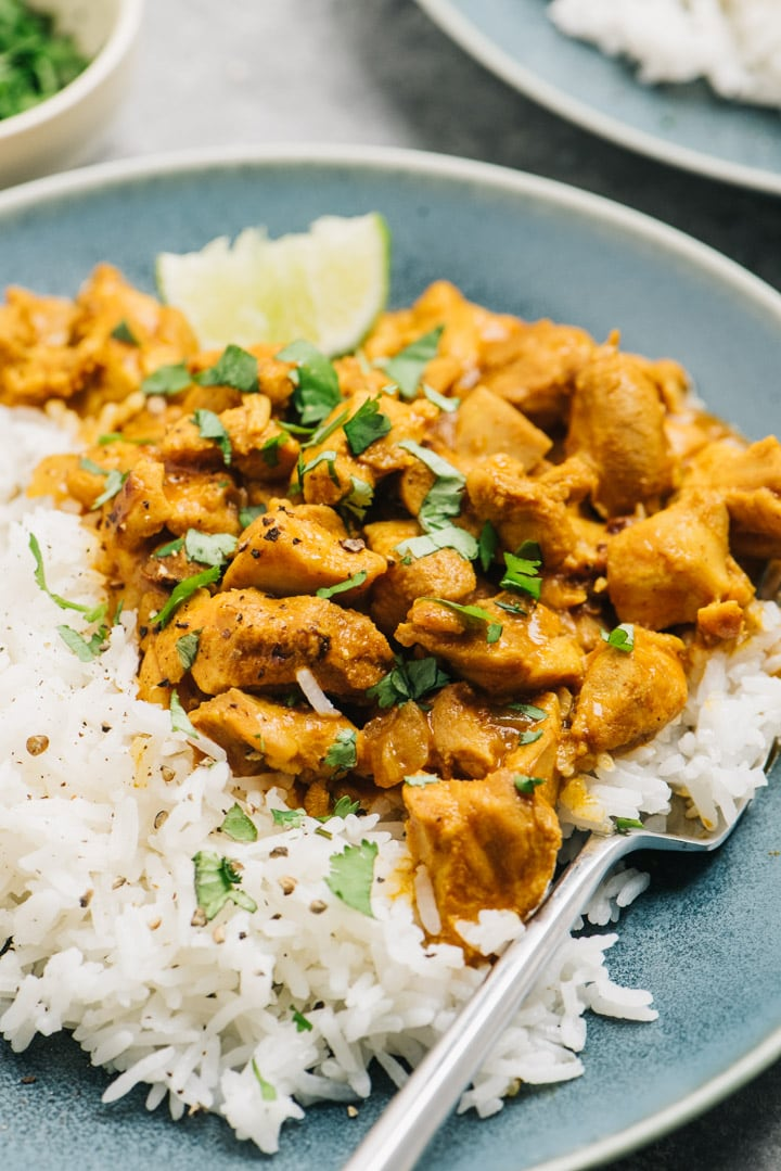 Coconut chicken curry garnished with fresh herbs