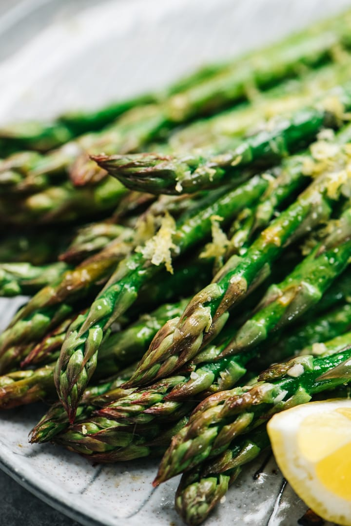 Side view of roasted lemon garlic asparagus.