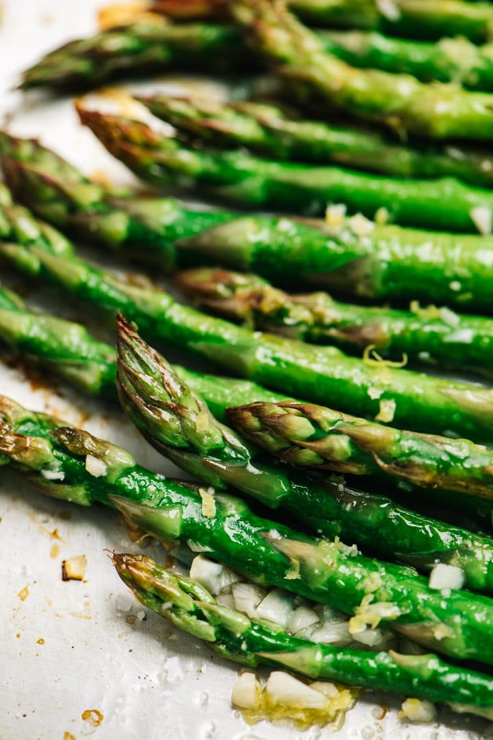Oven roasted garlic asparagus on a baking sheet fresh from the oven.