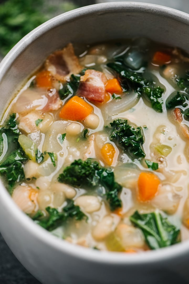 Close up of the white bean and kale soup in a bowl