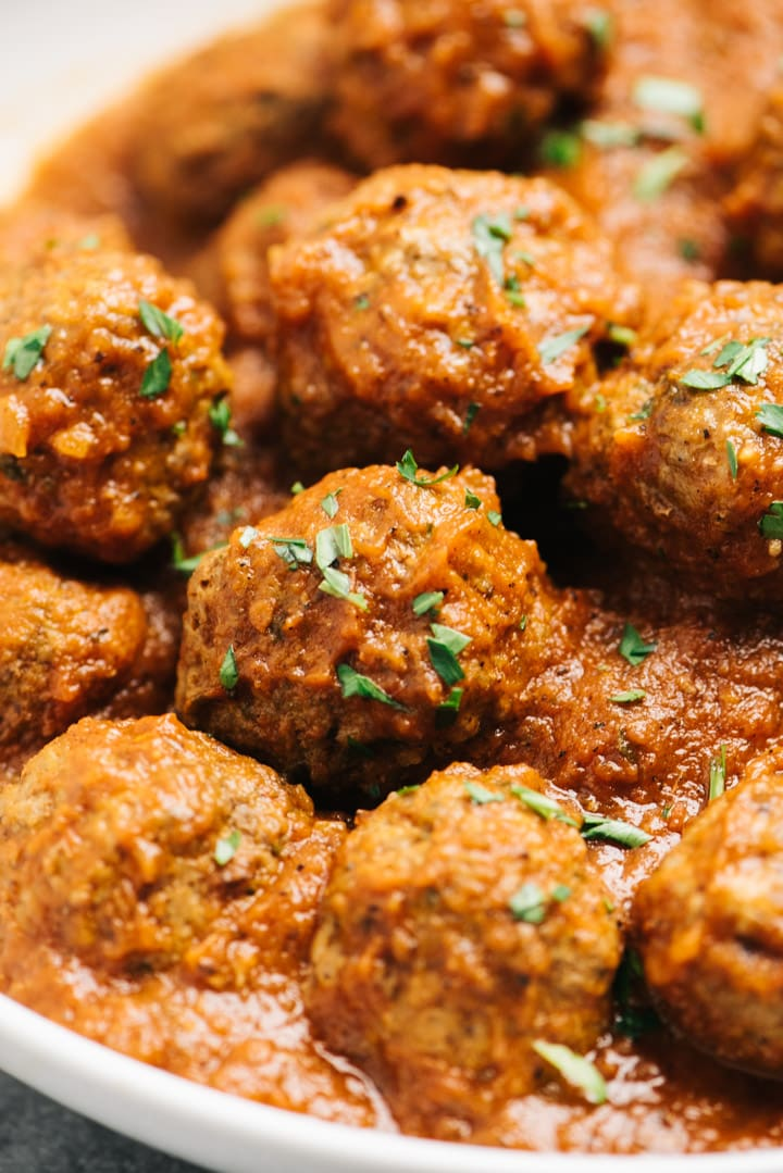 Close up of the meatballs sprinkled with fresh herbs