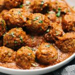 whole30 Italian meatballs served in sauce in a white bowl
