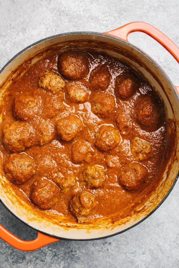 Meatballs and marinara sauce in a pot