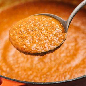 Whole30 marinara sauce in a ladle