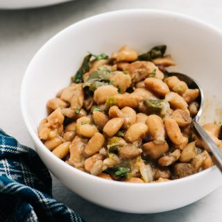 A small bowl of mexican style instant pot pinto beans.