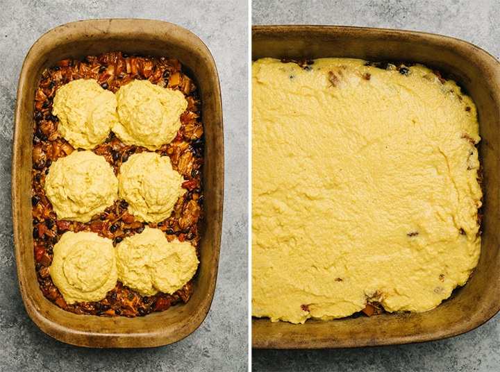 Dollops of cornbread batter over tamale pie filling in a casserole dish, and topping spread over the filling.