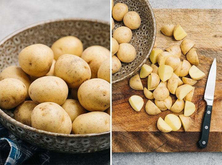 Baby yukon gold potatoes in a brown speckled bowl, and cut into quarters on a cutting board.