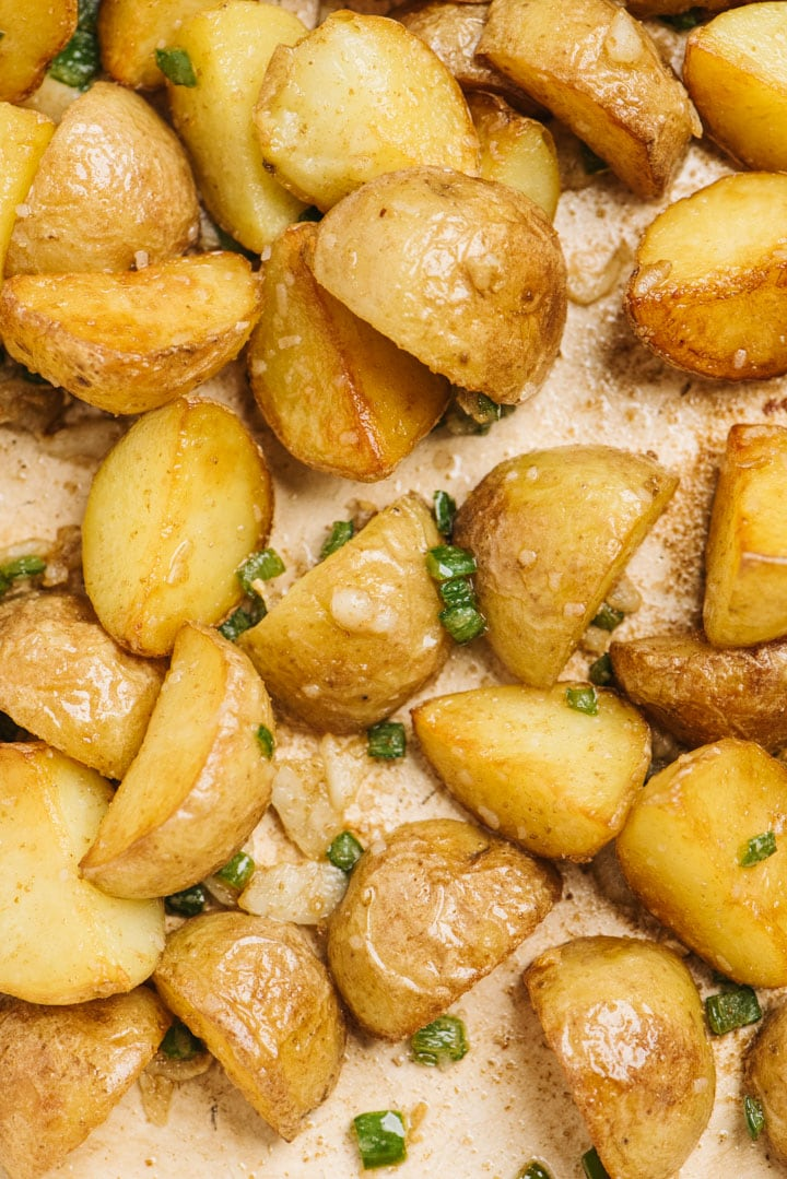 Detail image of spicy potatoes in a skillet.