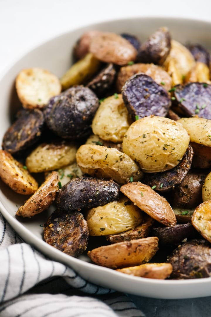 Side view, oven roasted potatoes seasoned with ranch seasoning, in a serving bowl.