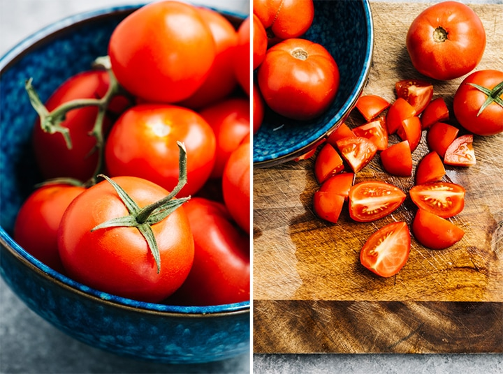 Ripe tomatoes in a blue bowl; quartered and diced tomatoes on a cutting board.l