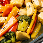 Side view of cooked chicken stir fry in a skillet.