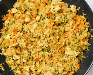 Cauliflower fried rice with in a non-stick skillet.