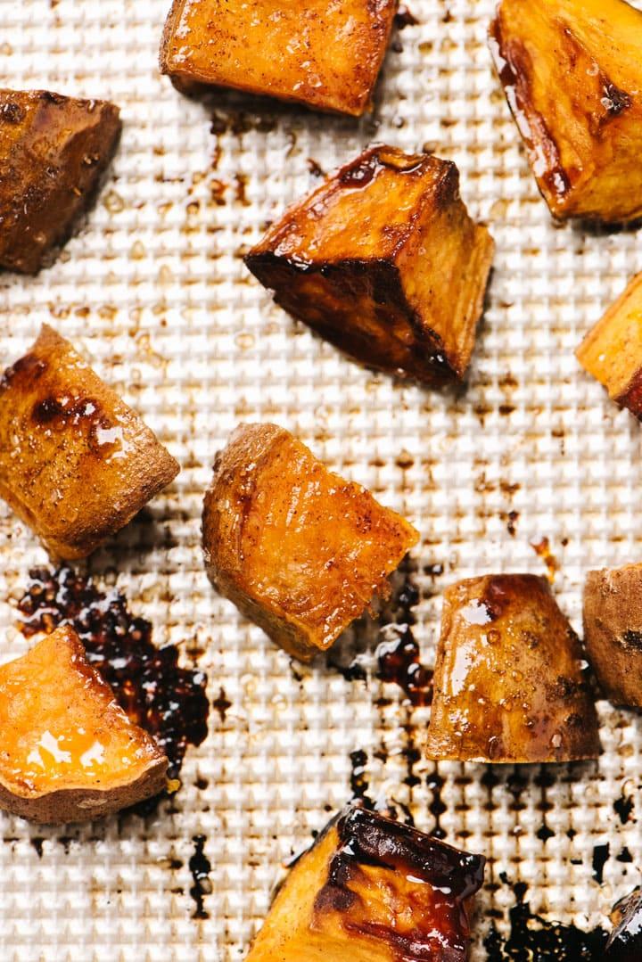 Cinnamon roasted sweet potatoes on a baking sheet.