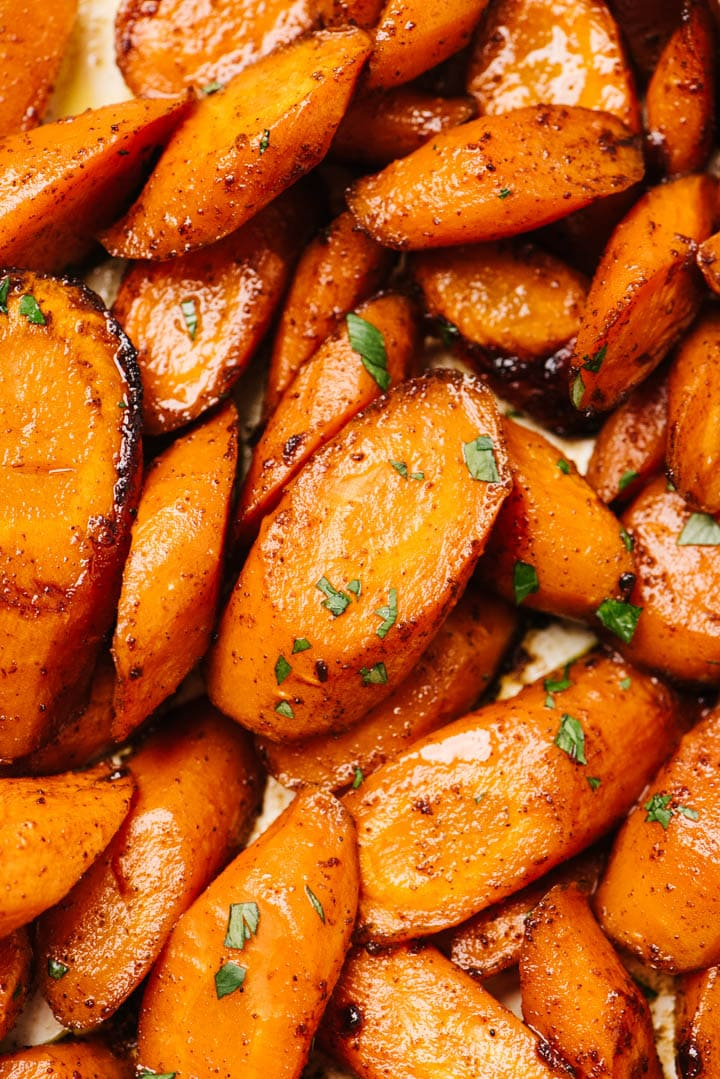 Detail image of roasted carrots with honey garnished with parsley.