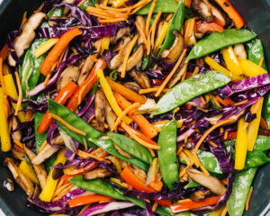 Sauteed rainbow stir fry vegetables in a skillet.