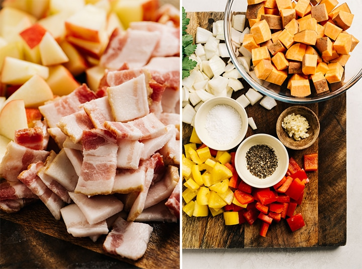 The ingredients for sweet potato bacon hash arranged on a cutting board - sweet potato, onion, bacon, apple, bell pepper, spices, and parsley.