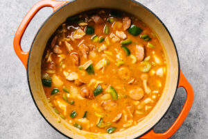 Chicken étouffée in a dutch oven before being simmered.