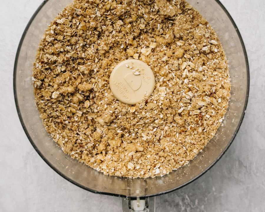 Gluten free topping for apple crisp in the bowl of a food processor.