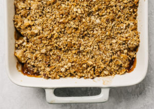 Gluten free apple crisp fresh from the oven in a casserole dish.