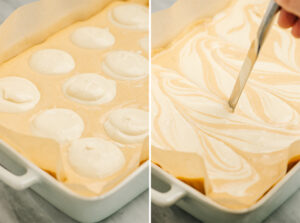 Plain cheesecake filling dolloped into a pumpkin cheesecake layer; a butter knife making swirls in the cheesecake.