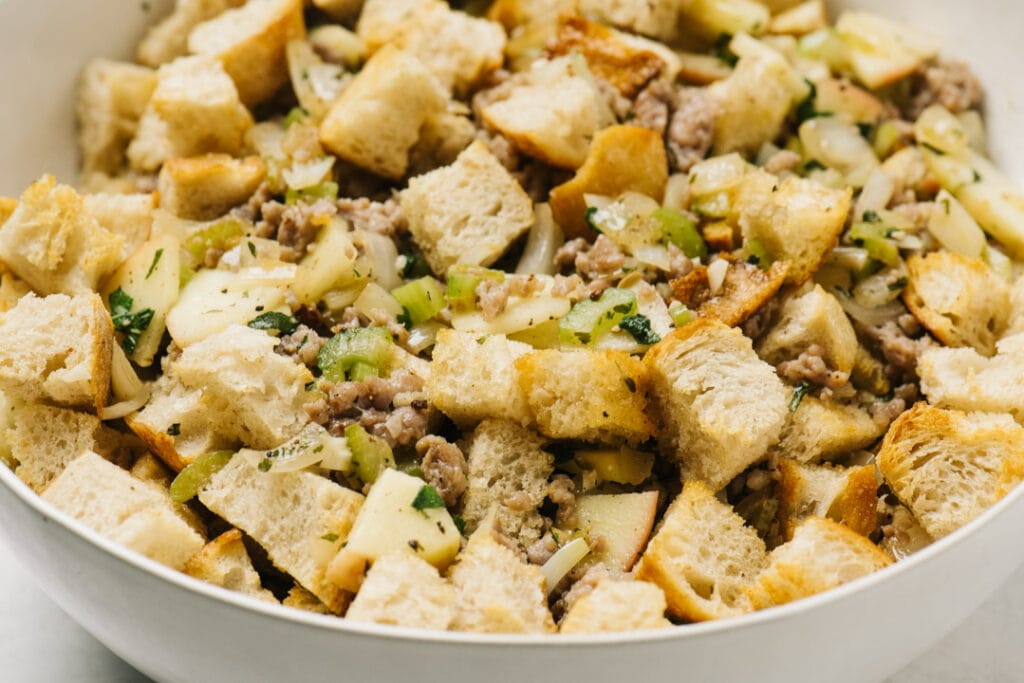 Bread cubes tossed with cooked italian sausage, apples, and vegetables.