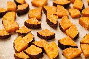 Roasted sweet potatoes on a baking sheet.