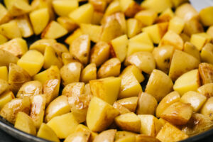 Sauteed yukon gold potatoes in a skillet.
